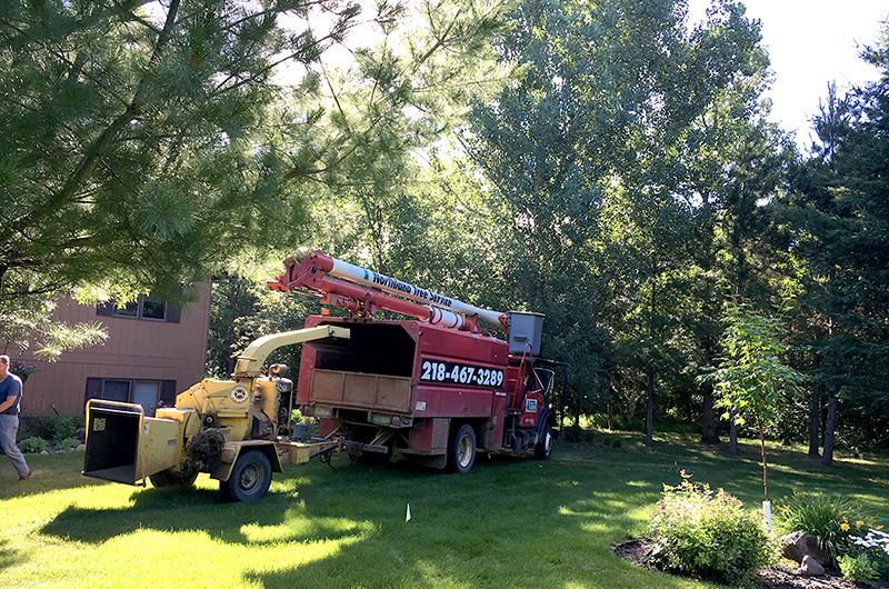 Northland tree service truck with chipper attached to the back